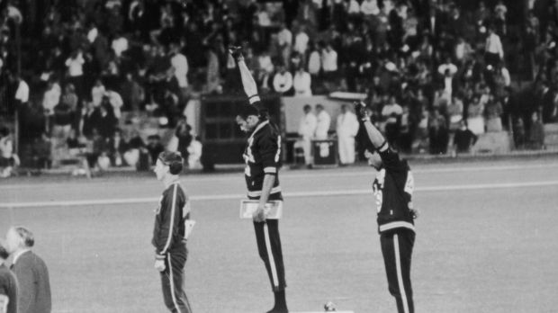 American sprinters Tommie Smith and John Carlos give the Black Power salute as they stand on the podium at the Mexico Olympics in 1968.