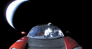 A cherry red Tesla Roadster automobile floats through space after it was carried there by SpaceX's Falcon Heavy. Photograph: SpaceX/Handout/Reuters