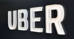 The  Uber logo is pictured outside its corporate HQ in San Francisco. Photograph: Josh Edelson / AFP / Getty Images