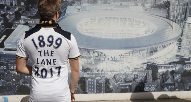 A Spurs fan looks at an artist s impression of the new stadium c5ce72022