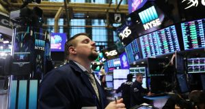 Traders on the floor of the New York Stock Exchange on Friday, when stocks repeatedly swung from gains to losses and back again. Photograph: Spencer Platt/Getty Images