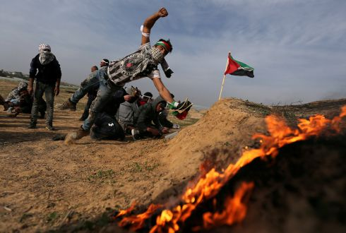 GAZA CLASHES: A Palestinian demonstrator during clashes with Israeli troops near the border with Israel in the southern Gaza Strip. Photograph: Ibraheem Abu Mustafa/Reuters