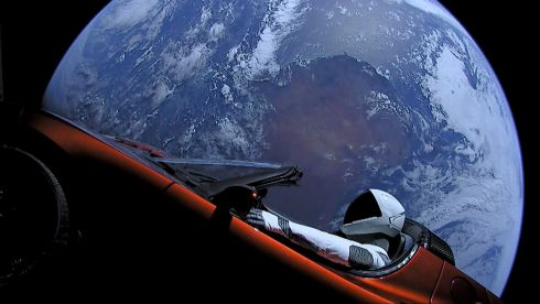 RUN OUT OF ROAD: A cherry red Tesla Roadster car floats through space after it was carried there by SpaceX's Falcon Heavy rocket. Photograph:   SpaceX/Reuters