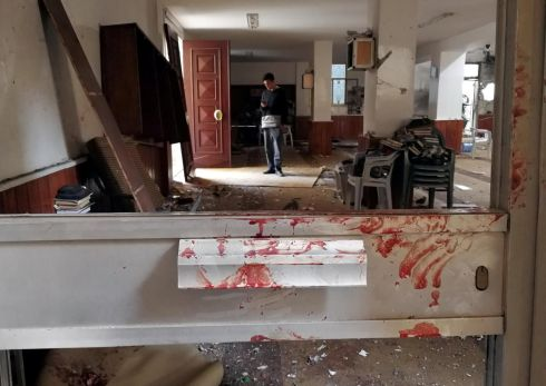MOSQUE BOMBING: Blood stains a door following a twin bombing inside a mosque in Benghazi, Libya. Photograph: Reuters