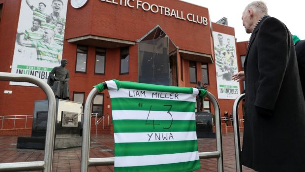 Tributes to Liam Miller outside Celtic Park ahead of the Scottish Cup fifth-round match. Photograph: Andrew Milligan/PA Wire