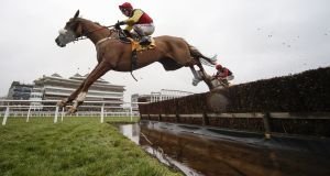 Richard Johnson riding Native River clear the water jump before winning The Betfair Denman Steeple Chase at Newbury. Photograph: Alan Crowhurst/Getty Images