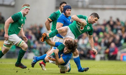 Rob Kearney is tackled hard by Tommaso Boni of Italy. Photograph: Inpho
