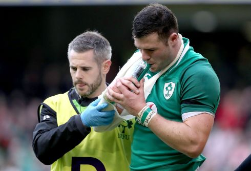 Robbie Henshaw receives medical attention after suffering a shoulder injury. Photograph: Inpho