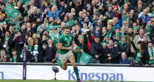 Jacob Stockdale runs in to score his second try. Photograph: Tom Honan/Irish Times