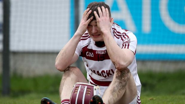 Slaughtneil's Brian Cassidy is dejected after the match. Photograph: Oisin Keniry/Inpho