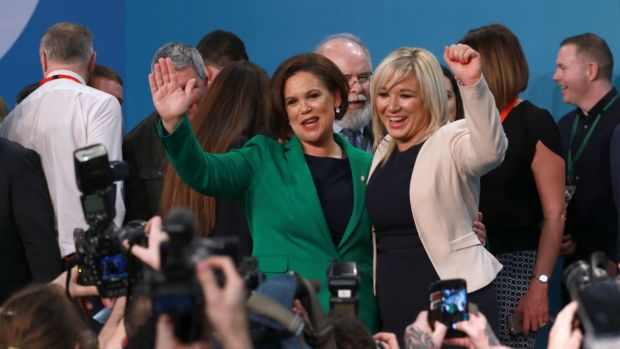 Sinn Féin president Mary Lou McDonald (centre) with deputy president Michelle O'Neill celebrating after their election at a party ardfheis at the RDS in Dublin. Photograph: Nick Bradshaw