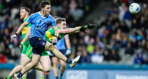 Dublin's Colm Basquel is challenged by Hugh McFadden of Donegal during the Allianz Football League Division One game at  Croke Park. Photograph: Laszlo Geczo/Inpho