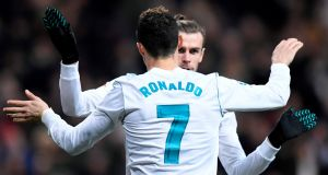 Cristiano Ronaldo celebrates with Real Madrid team-mate  Gareth Bale after scoring during the Spanish league match against  Real Sociedad at the Santiago Bernabeu stadium. Photograph: Gabriel Bouys/AFP/Getty Images