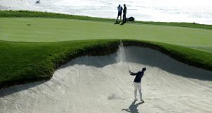 Rory McIlroy  plays his shot from the bunker on the ninth hole during the third round of the  AT&T Pebble Beach Pro-Am at Pebble Beach Golf Links in California. Photograph: Jeff Gross/Getty Images