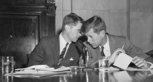 Robert F Kennedy (L) and his brother John F Kennedy confer at a hearing in Washington. Photograph: Getty