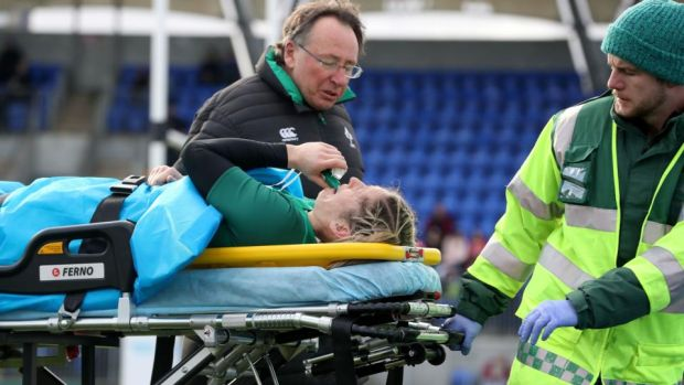 Ireland's Alison Miller goes off injured after fracturing her ankle. Photo: Bryan Keane/Inpho