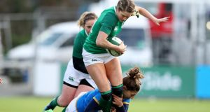 Ireland's Magan Williams is tackled by Sofia Stefan of Italy during their Six Nations clash. Photo: Bryan Keane/Inpho