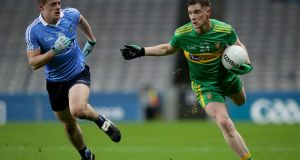Dublin's Brian Howard tracks Donegal's Ciarán Thompson during Saturday night's Allianz Football League Division One clash at  Croke Park. Photograph: Oisín Keniry/Inpho