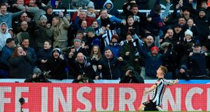 Newcastle United's Matt Ritchie celebrates with the crowd after scoring the opening goal of their win over Manchester United. Photo: Lindsey Parnaby/Getty Images
