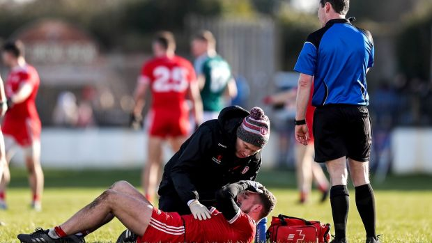 Tyrone's Niall Sludden receives medical attention. Photo: Laszlo Geczo/Inpho