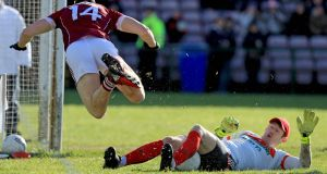 Mayo's David Clarke tackles Damien Comer of Galway. Photograph: Donall Farmer/Inpho