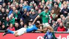 Jacob Stockdale gets past Jayden Hayward of Italy on his way to scoring Ireland's  eight try at the Aviva Stadium. Photograph: Dan Sheridan/Inpho