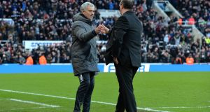 Jose Mourinho and Rafael Benitez shake hands after the Premier League match between Newcastle United and Manchester United at St. James Park. Photo: Mark Runnacles/Getty Images