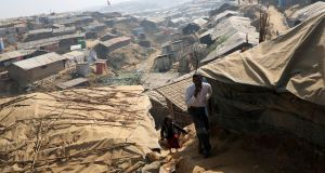 File photo: Rohingya refugees walk along the Kutupalong refugee camp in Cox's Bazar, Bangladesh. Photograph: Reuters/Mohammad Ponir Hossain