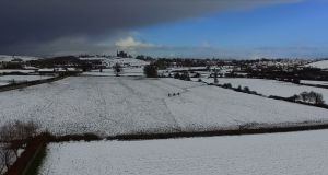 Rock of Cashel  surrounded by fields covered with snow on Sunday. Photograph: Joe Boland