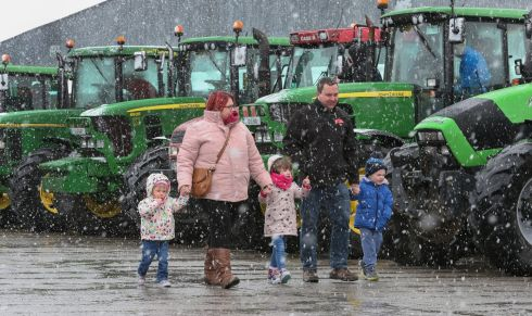 HAND IN HAND: Snow falls as visitors arrive for the East Galway Tractor Run 2018 at Athenry Mart. Proceeds are to go to Hand in Hand which provides families of children with cancer with much-needed practical support. Photograph: Joe O'Shaughnessy
