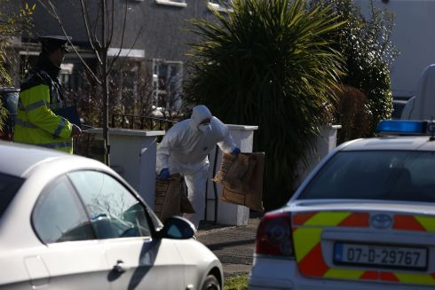 SUSPECTED ASSAULT: Members of the Garda technical bureau carry evidence from a property at Aubrey Grove, Shankill, Co Dublin. A three-year-old girl remains in a critical condition in hospital after a suspected assault. Photograph: Stephen Collins/Collins Photos