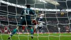 Tottenham's Harry Kane powers home a downward header to score the winning goal in the London derby against Arsenal. Photograph: Andrew Couldridge/Reuters