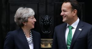 Theresa May and Leo Varadkar: sources said it was unlikely the two leaders would attend  negotiations unless they had relative certainty a deal between the DUP and Sinn Féin was imminent.  Photograph: Daniel Leal-Olivas/AFP/Getty Images