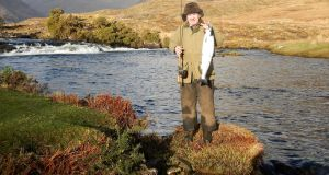 Mr Pat Hagan from Co Dublin with the first salmon of the season at Delphi Lodge, Connemara.