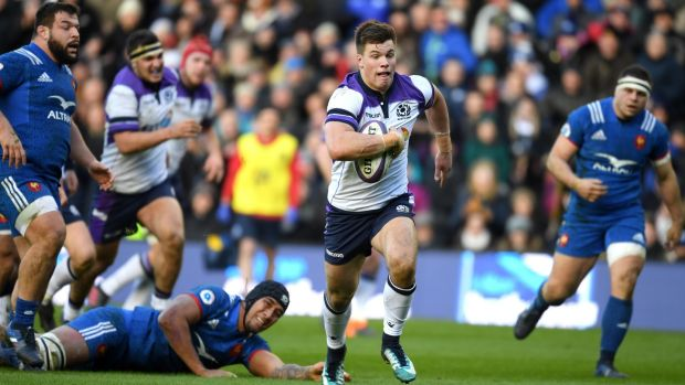 Huw Jones breaks to score for Scotland against France. Photograph: Mike Hewitt/Getty