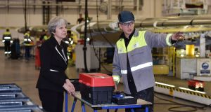 British prime minister Theresa May speaks to a worker during a visit to the Bombardier factory in Belfast before meeting the main political parties at Stormont, for talks aimed at ending the 13-month political stalemate. Photograph: Charles McQuillan/PA Wire