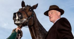 "Douvan with his trainer Willie Mullins: ""I'm very happy with his progress."" Photograph: James Crombie/Inpho"