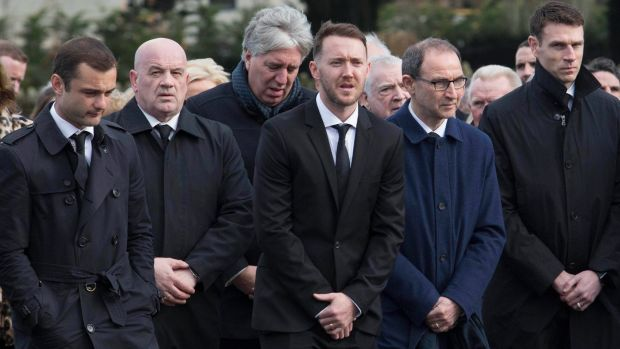 Shaun Maloney (left), Aiden McGeady (centre) and Martin O'Neill (second right) attend the funeral of former Republic of Ireland footballer Liam Miller, at St John the Baptist Church in Ovens, Co Cork. Photograph: Clare Keogh/PA Wire