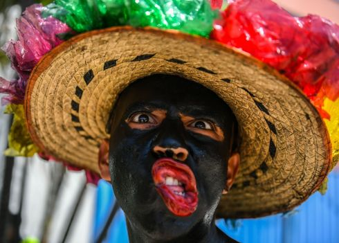 "BARRANQUILLA CARNIVAL: Reveller named ""Son de Negro"" poses before the carnival parade in Barranquilla, Colombia. Photograph: Luis Acosta/AFP/Getty Images"