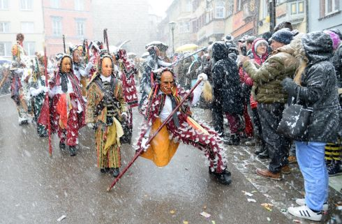"RIDERS ON THE STORM: Carnival revellers march during the traditional folklore ""Narrensprung"" (fools jump) procession on Rose Monday in the Black Forest town of Rottweil. Photograph: Steffen Schmidt/Reuters"