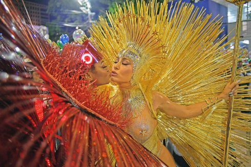 SULTRY SAMBA: Brazilian personality Sabrina Sato (right) performs with the Vila Isabel samba school on the first night of Rio's Carnival at the Sambadrome in Rio de Janeiro. Photograph: Carl de Souza/AFP/Getty Images