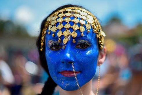 "CONNECTING CULTURES: A member of the ""Pena de Pavao de Krishna"" traditional carnival group which celebrates Indian deities performs in Belo Horizonte, Brazil. Photograph: Douglas Magno/AFP/Getty Images"