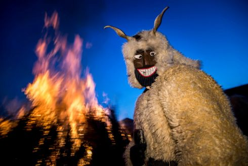 WOLF IN SHEEP'S CLOTHING: Revellers wearing a sheepfur costume with horns and a masks pose next to a bonfire in Mohacs, some 210km south of Budapest, during a traditional carnival parade. The carnival parade is a revival of a legend, which says the ethnic Croats crossed the river to ambush the Osmanli Turkish troops, who escaped in panic seeing the terrifying figures during the Turkish occupation of Hungary. Photograph: Tamas Soki/EPA