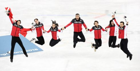 JUMPING FOR JOY: Team Canada (from left) Scott Moir, Tessa Virtue, Gabrielle Daleman, Eric Radford, Meagan Duhamel, Kaetlyn Osmond and Patrick Chan celebrate after winning the Figure Skating Team Event at the Gangneung Ice Arena during in South Korea. Photograph: Tatyana Zenkovich/EPA