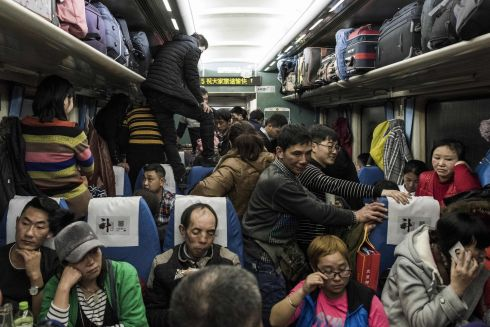 HOME FOR THE HOLIDAYS: Passengers travelling on a crowded train during the 26-hour journey from Beijing to Chengdu, in Shijiazhuang, as they head home ahead of the Lunar New Year. Photograph: Fred Dufour/AFP/Getty Images
