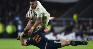 England's number 8 Nathan Hughes is tackled by France's  Guilhem Guirado during their Six Nations  match  at Twickenham earlier this month. Photograph: Glyn Kirk/AFP/Getty Images