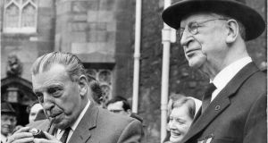 Attending the Michael Collins memorial mass in The Church of The Most Holy Trinity, Dublin Castle, were (right) President de Valera and Mr Seán Lemass FF TD. Photograph: Paddy Whelan