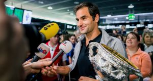 Roger Federer arrives at Airport Kloten with his trophy after winning the 2018 Australian Open. Photograph: Remy Steiner/Getty Images