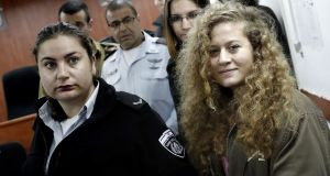Ahed Tamimi (17) arrives for the beginning of her trial in the Israeli military court at Ofer military prison in the West Bank village of Betunia on Tuesday. Photograph:  Thomas Coex/AFP/Getty Images