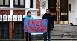 Assange supporters hold a banner outside the Ecuadorian Embassy in London. Photograph: Reuters